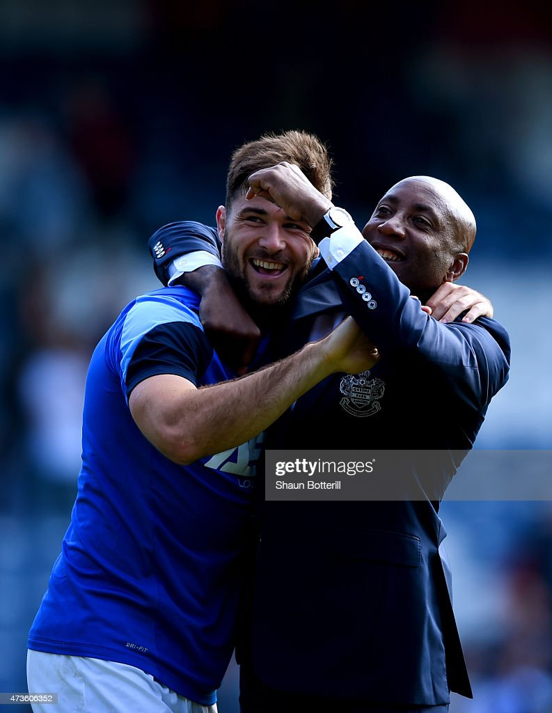Charlie Austin and Chris Ramsey of QPR are seen after the Barclays Premier League match between Queens Park Rangers and Newcastle United at Loftus Road on May 16, 2015 in London, England.