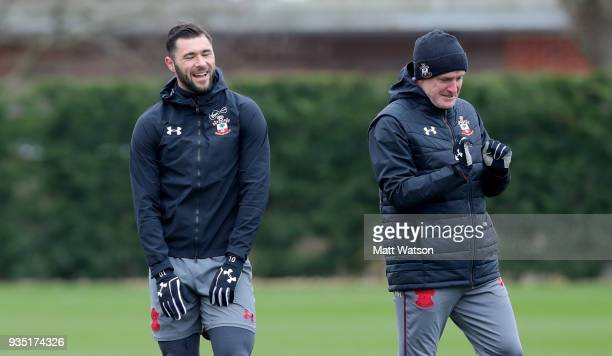 Charlie Austin and Mark Hughes during a Southampton FC training session at the Staplewood Campus on March 20 2018 in Southampton England