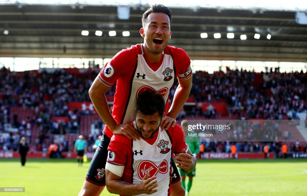 Charlie Austin and Maya Yoshida of Southampton celebrate during the Premier League match between Southampton and West Ham United at St Mary's Stadium on August 19, 2017 in Southampton, England.
