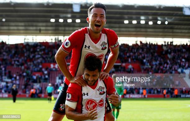 Charlie Austin and Maya Yoshida of Southampton celebrate during the Premier League match between Southampton and West Ham United at St Mary's Stadium...