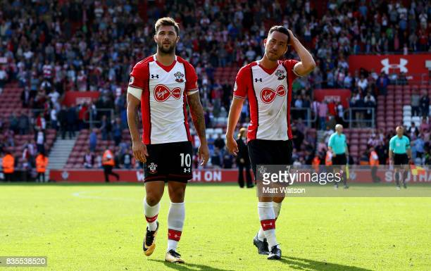Charlie Austin and Maya Yoshida of Southampton during the Premier League match between Southampton and West Ham United at St Mary's Stadium on August...