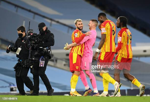 Charlie Austin and Sam Johnstone of West Bromwich Albion embrace after the Premier League match between Manchester City and West Bromwich Albion at...
