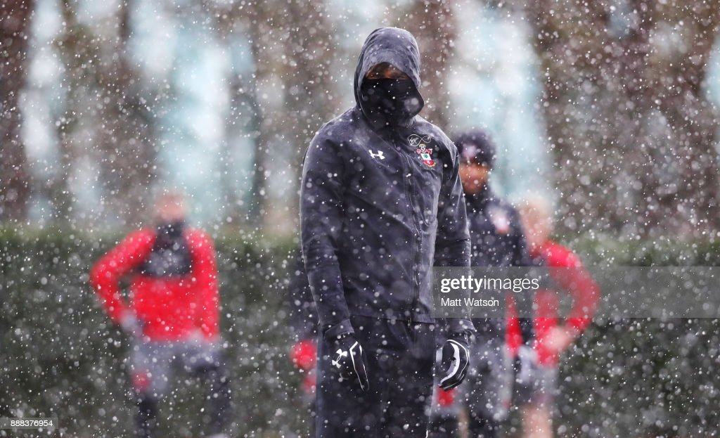 Charlie Austin as snow falls during a Southampton FC training session at the Staplewood Campus on December 8, 2017 in Southampton, England.