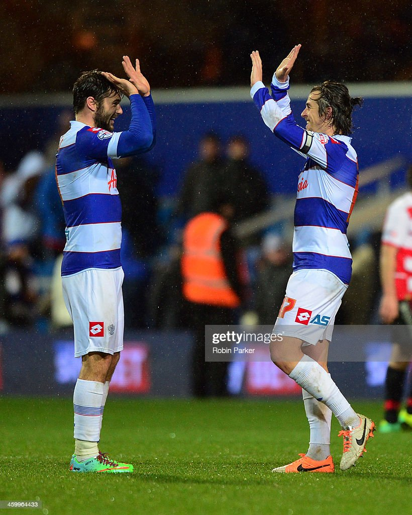 Charlie Austin (L) celebrates with Joey Barton of Queens Park Rangers after the final whistle at the end of the Sky Bet Championship match between Queens Park Rangers and Doncaster Rovers at Loftus Road on January 1, 2014 in London, England,