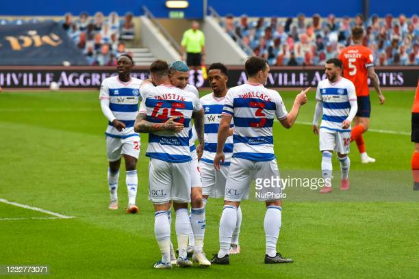 Charlie Austin of QPR celebrates after scoring his team's first goal with his team mates during the Sky Bet Championship match between Queens Park...