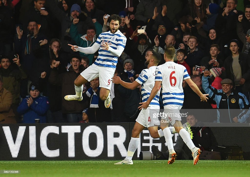 Charlie Austin of QPR celebrates scoring his second goal during the Barclays Premier League match between Queens Park Rangers and West Bromwich Albion at Loftus Road on December 20, 2014 in London, England.
