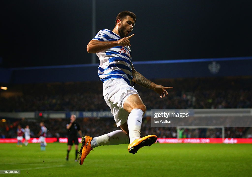 Charlie Austin of QPR celebrates scoring the opening goal during the Barclays Premier League match between Queens Park Rangers and Aston Villa at Loftus Road on October 27, 2014 in London, England.