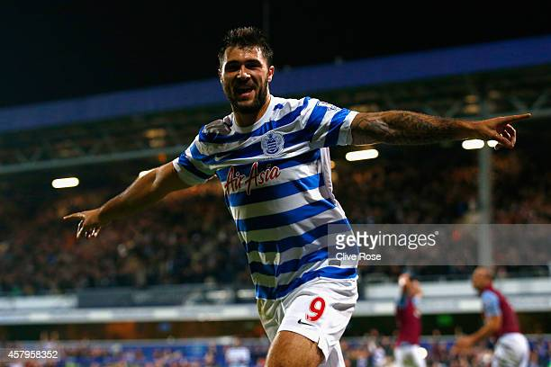 Charlie Austin of QPR celebrates scoring their second goal during the Barclays Premier League match between Queens Park Rangers and Aston Villa at...
