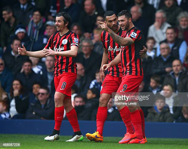 Charlie Austin of QPR celebrates scoring their second goal with Steven Caulker and Joey Barton of QPR during the Barclays Premier league match West...