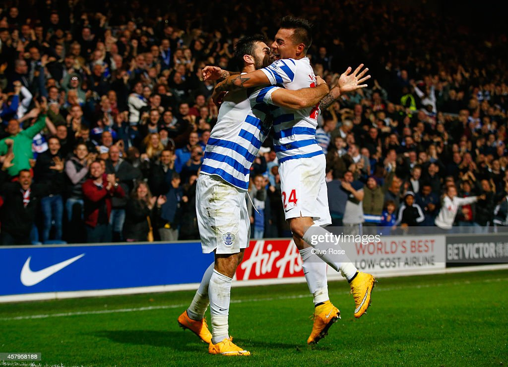 Charlie Austin of QPR (L) celebrates scoring their second goal with Eduardo Vargas of QPR during the Barclays Premier League match between Queens Park Rangers and Aston Villa at Loftus Road on October 27, 2014 in London, England.