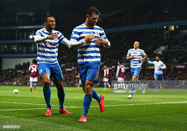 Charlie Austin of QPR celebrates with Matt Phillips as he scores their third goal during the Barclays Premier League match between Aston Villa and...