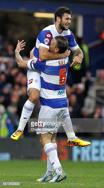 Charlie Austin of QPR celebrates with team mate Clint Hill after scoring the first goal of the game during the Sky Bet Championship match between...