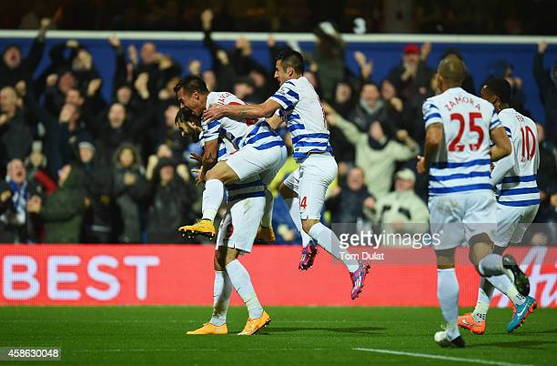 Charlie Austin of QPR celebrates with team mates as he scores their first goal during the Barclays Premier League match between Queens Park Rangers...