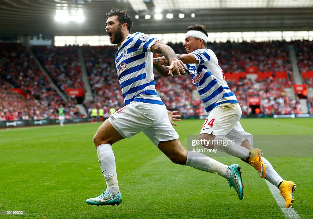 Charlie Austin (L) of QPR celebrates with team-mate Eduardo Vargas after scoring their first goal during the Barclays Premier League match between Southampton and Queens Park Rangers at St Mary's Stadium on September 27, 2014 in Southampton, England.
