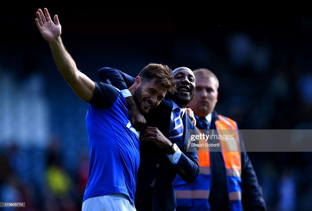 Charlie Austin of QPR hugs Chris Ramsey of QPR during the Barclays Premier League match between Queens Park Rangers and Newcastle United at Loftus Road on May 16, 2015 in London, England.