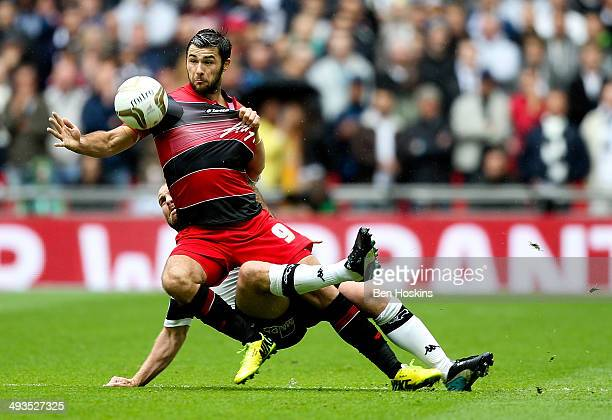Charlie Austin of QPR is bought down by Jake Buxton of Derby during the Sky Bet Championship Playoff Final match between Derby County and Queens Park...