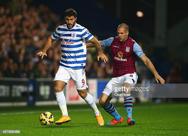 Charlie Austin of QPR is marshalled by Ron Vlaar of Aston Villa during the Barclays Premier League match between Queens Park Rangers and Aston Villa...