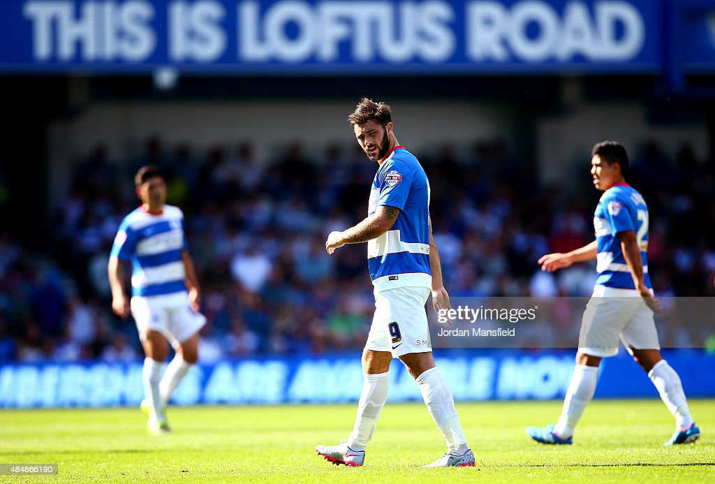 Charlie Austin of QPR (C) looks on during the Sky Bet Championship match between Queens Park Rangers and Rotherham United at Loftus Road on August 22, 2015 in London, England.
