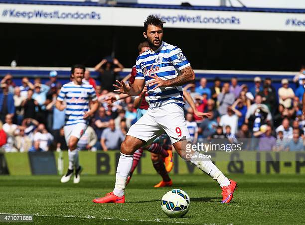 Charlie Austin of QPR reacts after missing a pnalty during the Barclays Premier League match between Queens Park Rangers and West Ham United at...