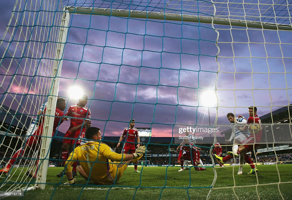 Charlie Austin of QPR scores his second goal during the Barclays Premier League match between Queens Park Rangers and West Bromwich Albion at Loftus Road on December 20, 2014 in London, England.