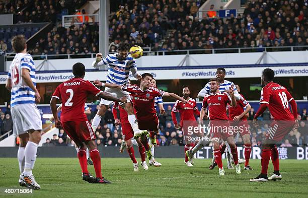 Charlie Austin of QPR scores his third goal with a header during the Barclays Premier League match between Queens Park Rangers and West Bromwich...