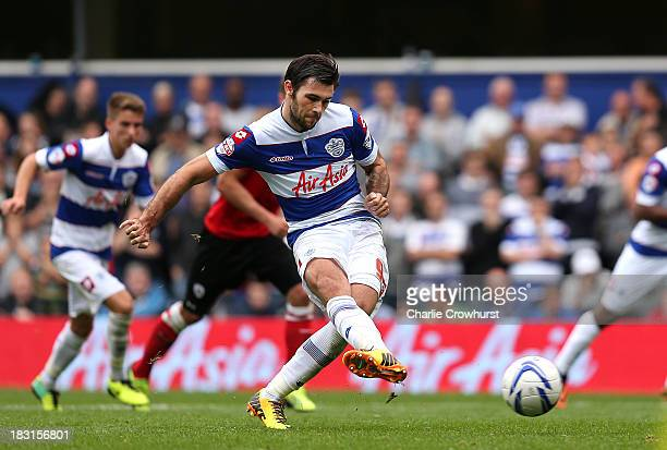 Charlie Austin of QPR scores the tea'ms second goal of the game from the penalty spot during the Sky Bet Championship match between Queens Park...