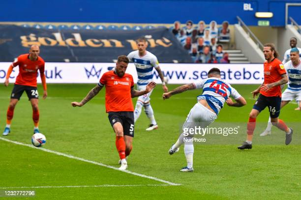 Charlie Austin of QPR shoots and score his teams first goal during the Sky Bet Championship match between Queens Park Rangers and Luton Town at...
