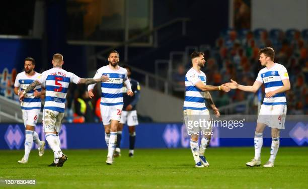 Charlie Austin of Queens Park Rangers celebrates after scoring their team's first goal with Rob Dickie during the Sky Bet Championship match between...