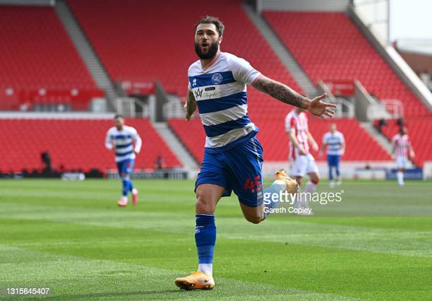 Charlie Austin of Queens Park Rangers celebrates after scoring their team's first goal during the Sky Bet Championship match between Stoke City and...