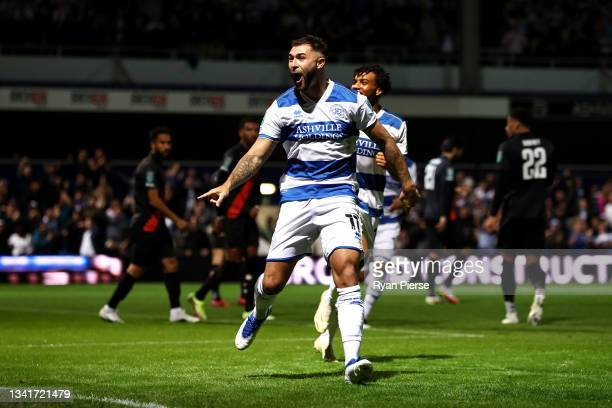 Charlie Austin of Queens Park Rangers celebrates after scoring their sides first goal during the Carabao Cup Third Round match between Queens Park...