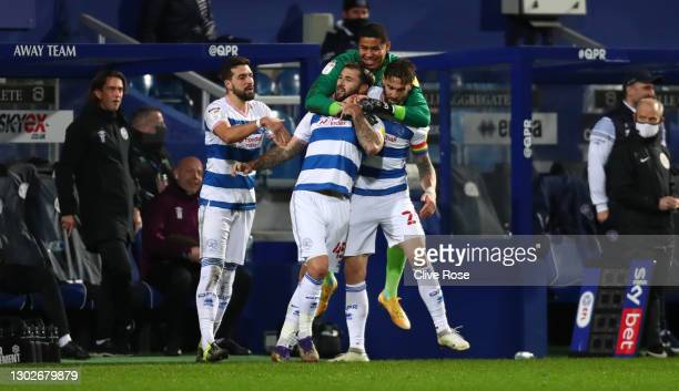 Charlie Austin of Queens Park Rangers celebrates with Geoff Cameron and Seny Dieng after scoring his team's second goal during the Sky Bet...