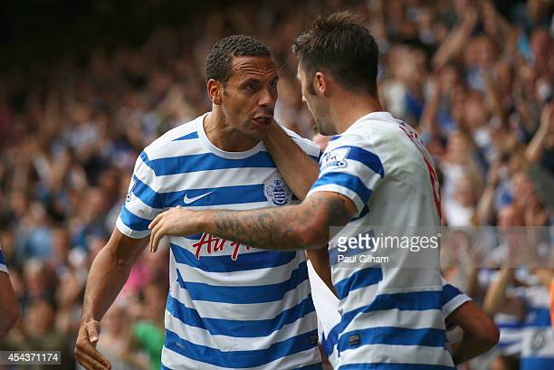 Charlie Austin of Queens Park Rangers celebrates with Rio Ferdinand afer scoring the opening goal for Queens Park Rangers during the Barclays Premier...