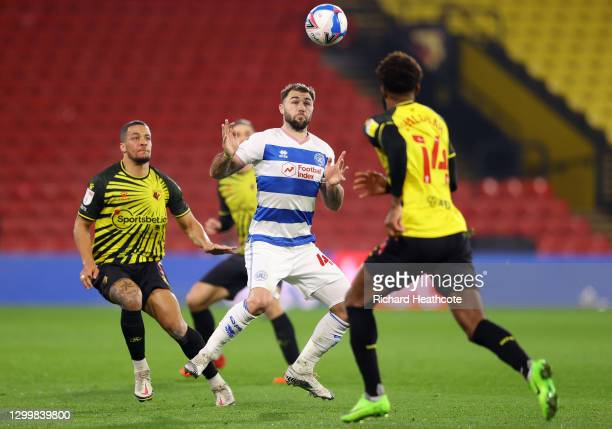 Charlie Austin of Queens Park Rangers controls the ball under pressure from William Troost-Ekong of Watford FC during the Sky Bet Championship match...