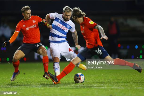 Charlie Austin of Queens Park Rangers shoots while under pressure from Kiernan Dewsbury-Hall and Glen Rea of Luton Town during the Sky Bet...