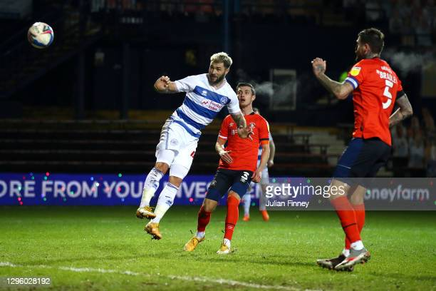 Charlie Austin of Queens Park Rangers wins a header during the Sky Bet Championship match between Luton Town and Queens Park Rangers at Kenilworth...