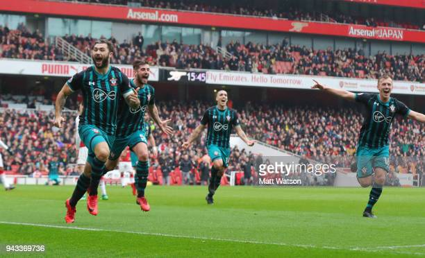 Charlie Austin of Southampton celebrates after equalising during the Premier League match between Arsenal and Southampton at Emirates Stadium on...