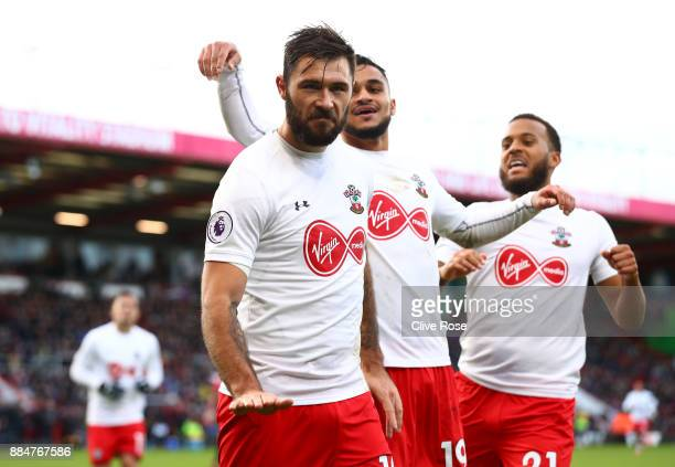 Charlie Austin of Southampton celebrates after scoring his sides first goal with Sofiane Boufal of Southampton and Ryan Bertrand of Southampton...