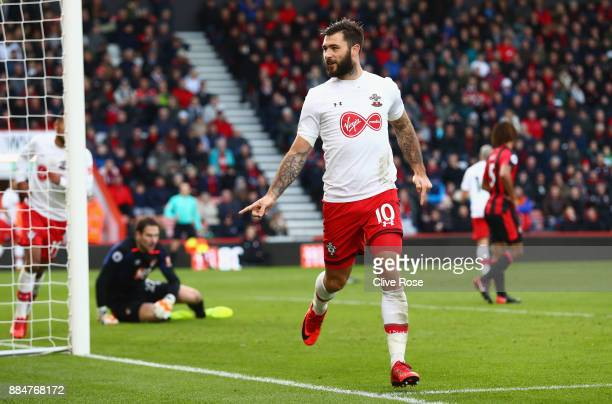 Charlie Austin of Southampton celebrates after scoring his sides first goal during the Premier League match between AFC Bournemouth and Southampton...