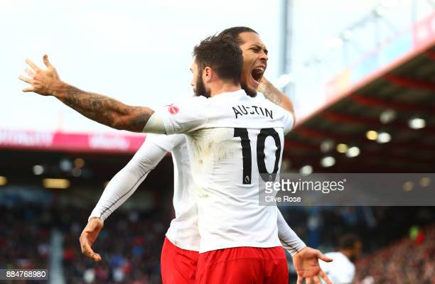 Charlie Austin of Southampton celebrates after scoring his sides first goal with Virgil van Dijk of Southampton during the Premier League match...