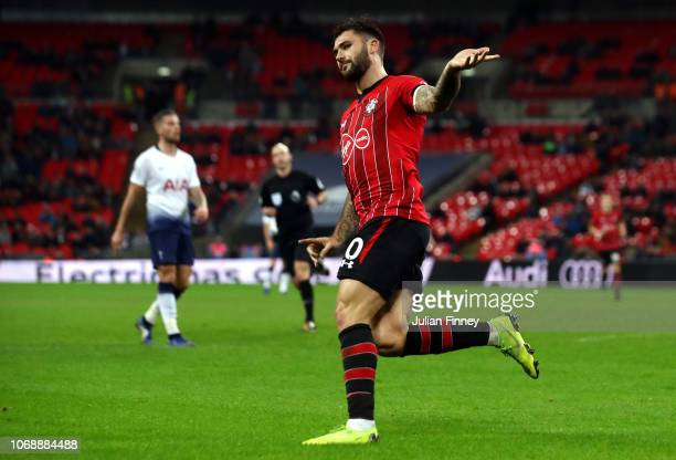 Charlie Austin of Southampton celebrates after scoring his team's first goal during the Premier League match between Tottenham Hotspur and...