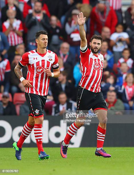 Charlie Austin of Southampton celebrates as he scores their third goal from the penalty spot during the Premier League match between Southampton and...