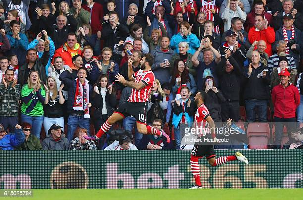 Charlie Austin of Southampton celebrates in front of fans as he scores their first goal during the Premier League match between Southampton and...