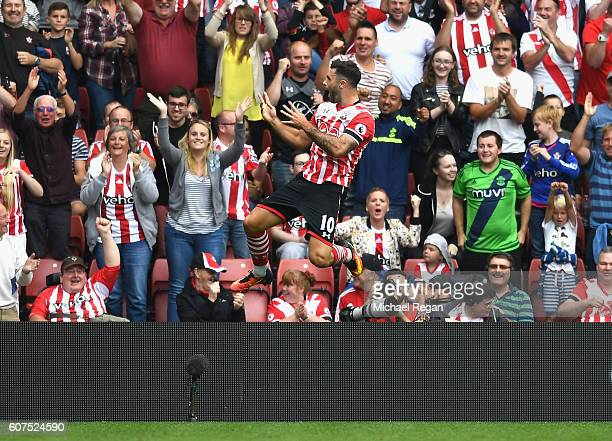 Charlie Austin of Southampton celebrates scoring his sides first goal during the Premier League match between Southampton and Swansea City at St...