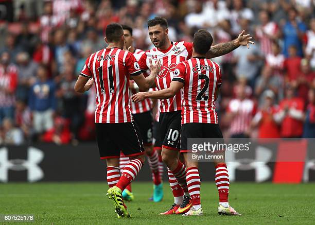 Charlie Austin of Southampton celebrates scoring his sides first goal with his team mates during the Premier League match between Southampton and...