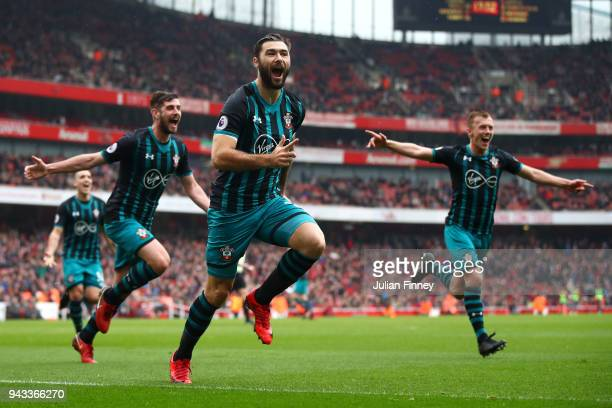 Charlie Austin of Southampton celebrates scoring his sides second goal during the Premier League match between Arsenal and Southampton at Emirates...
