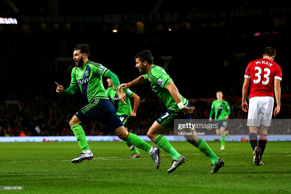 Charlie Austin (L) of Southampton celebrates scoring his team's first goal with his team mate Shane Long (R) during the Barclays Premier League match between Manchester United and Southampton at Old Trafford on January 23, 2016 in Manchester, England.