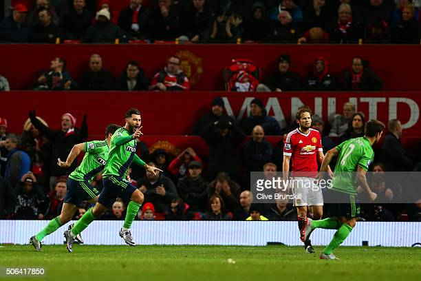 Charlie Austin of Southampton celebrates scoring his team's first goal during the Barclays Premier League match between Manchester United and...
