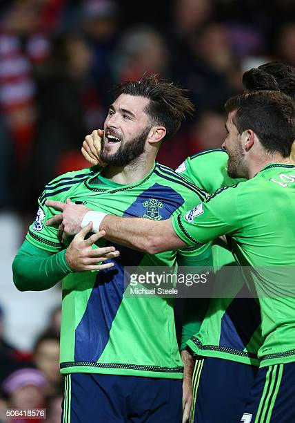 Charlie Austin of Southampton celebrates scoring his team's first goal with his team mates during the Barclays Premier League match between...