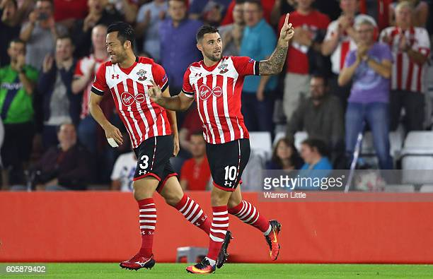 Charlie Austin of Southampton celebrates scoring his teams opener with teammate Maya Yoshida during the UEFA Europa League Group K match between...
