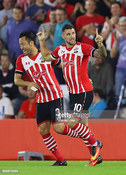 Charlie Austin of Southampton celebrates scoring his teams opener with teammate Maya Yoshida during the UEFA Europa League Group K match between...